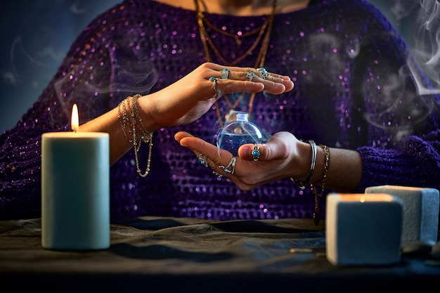 Fantasy witch woman using enchanting magical elixir potion bottle for love spell and witchcraft. magic illustration and alchemy