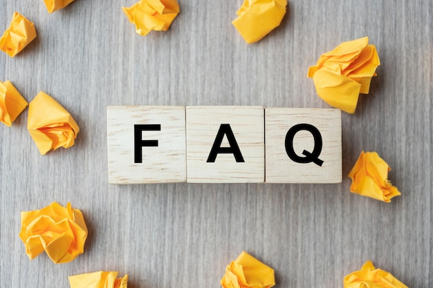 Faq( frequency asked questions) word with wooden cube block
