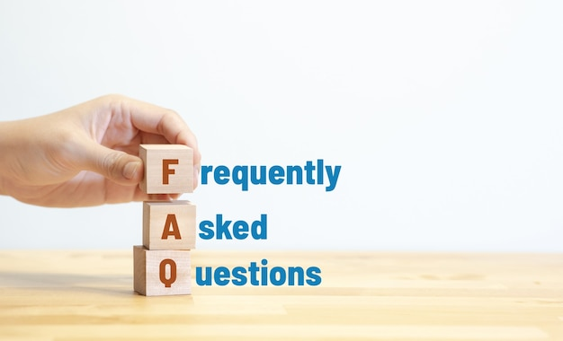 Faq ,frequently asked questions concepts with text on wood