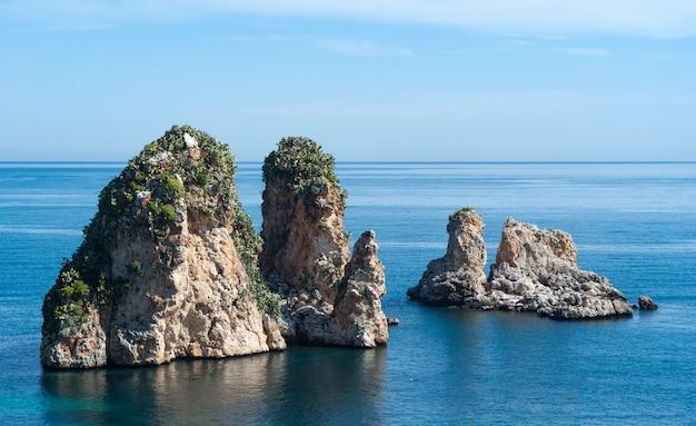Faraglioni rocks at scopello, sicily