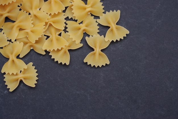 Farfalle pasta isolated dark
