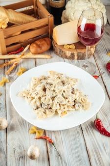 Farfalle pasta with mushrooms and creamy sauce