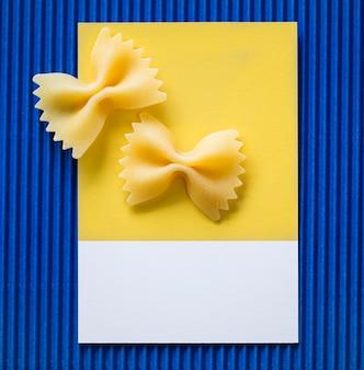 Farfalle pasta on a yellow card
