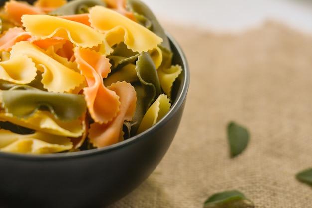 Farfalle tricolor organic healthy food. italian pasta