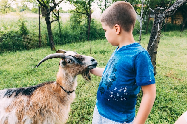 Farm concept with boy and goat