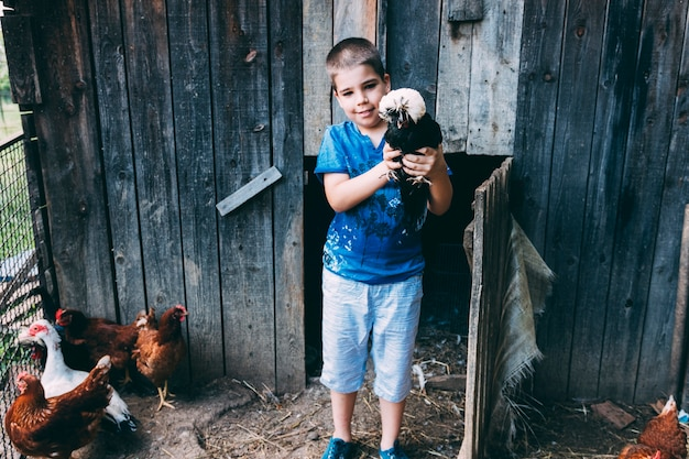 Farm concept with kid holding turkey
