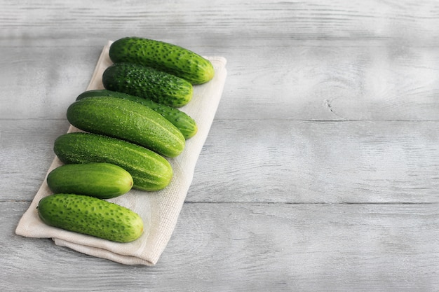 Farm cucumbers on wooden background. close-up, copy space.