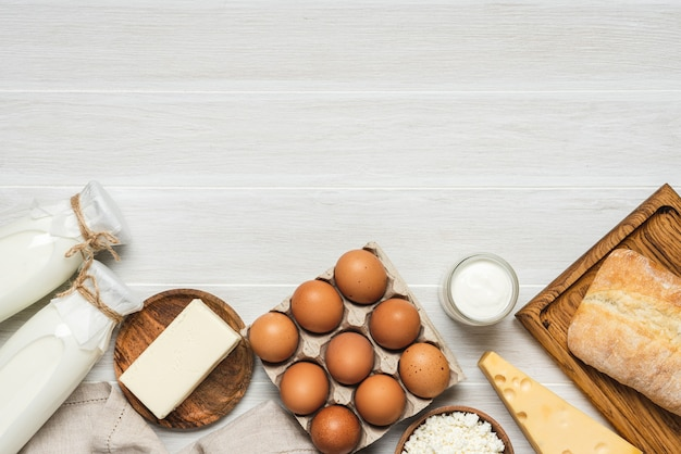 Farm dairy products. bottle milk, cheeses, cottage cheese, eggs, yogurt, butter, bread. organic food