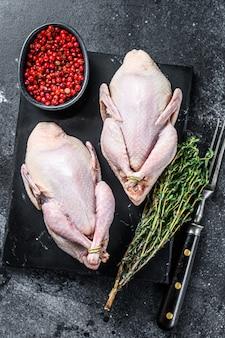 Farm eco friendly raw quails ready for cooking