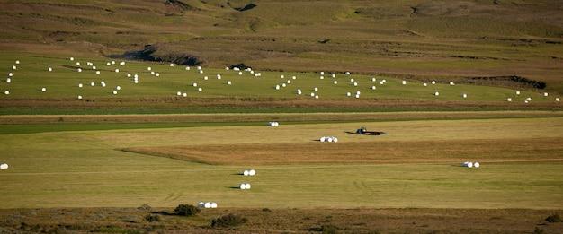 Farm fields with hay bales