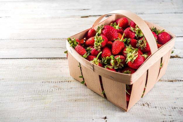 Farm organic strawberries in a basket.