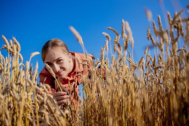 Farmer checking wheat field progress