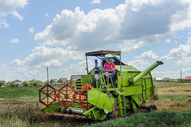 The farmer on the combine harvester is harvesting a grain. pidhiriya. ivano frankivsk state. ukraine. july 29, 2017.