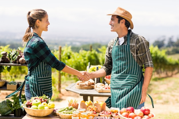 Farmer couple shaking hands with each other