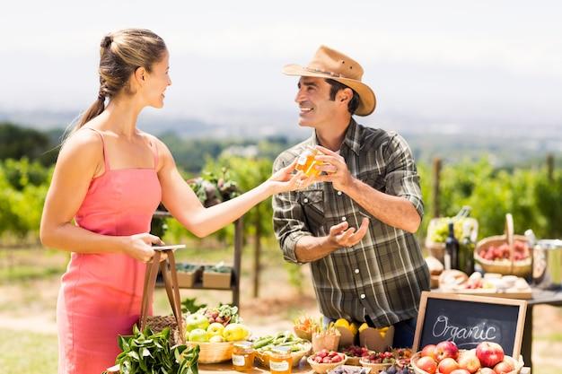 Farmer selling his organic produce to customer