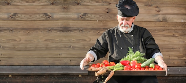 Farmer with a basket of fresh vegetables in the country
