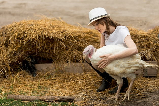 Farmer with a turkey in a farm