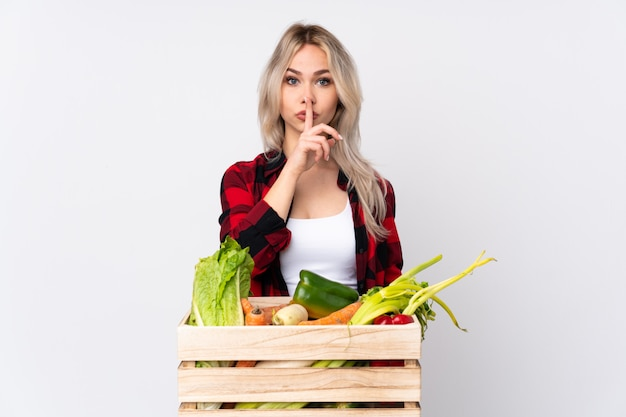 Farmer woman with vegetables box
