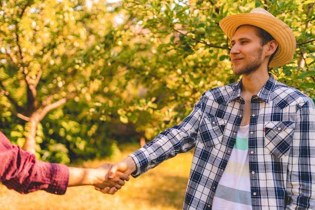 Farmers shake hands