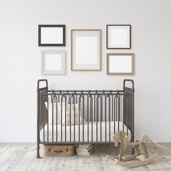 Farmhouse nursery. black metal crib near white wall. five different frames on the wall. interior and frame mockup. 3d rendering.