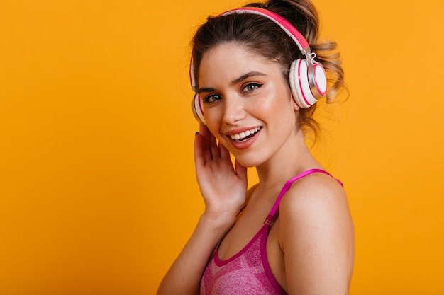 Fascinating fitness woman listening to music