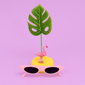 Fashion accessories sunglasses. minimal flat lay art. beach tropical concept