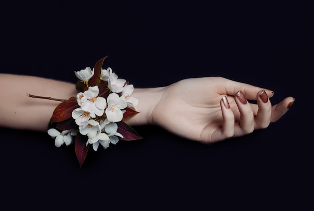 Fashion art hand woman in summer time and flowers
