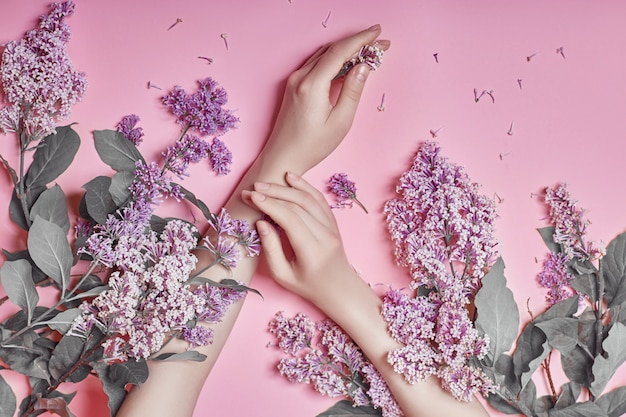 Fashion art hands natural cosmetics lilac flowers