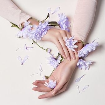 Fashion art skin care hands and blue flowers women