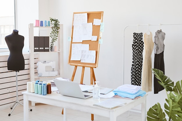 Fashion atelier with idea board and desk with clothing line