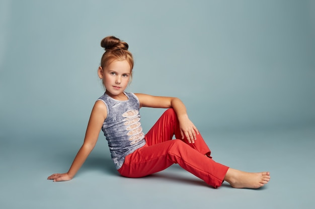 Fashion beautiful girl posing on blue