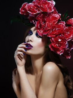 Fashion beauty model girl with flowers hair. bride. perfect creative make up and hair style