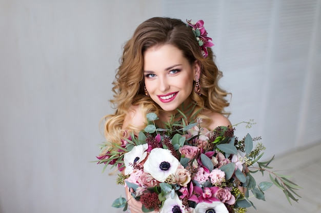 Fashion beauty model girl with flowers hair.