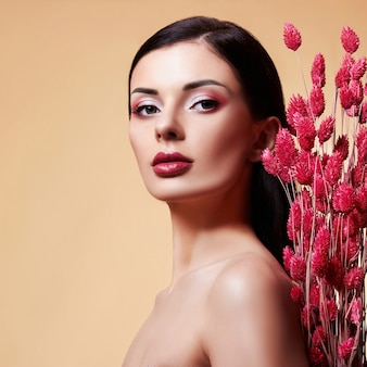 Fashion beauty model girl with flowers.