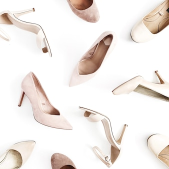 Fashion blog look. pale pink women high heel shoes on white background. flat lay, top view
