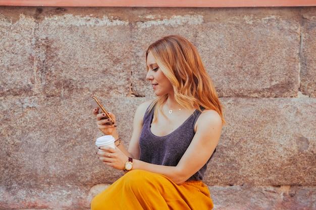 Fashion blogger woman using new technologies