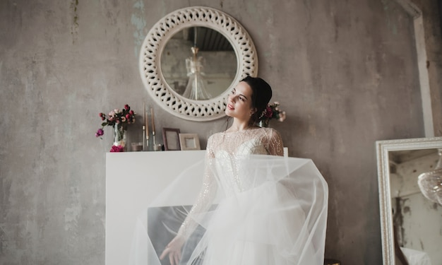 Fashion bride in gorgeous wedding dress portrait. beautiful model with bridal makeup and hairstyle