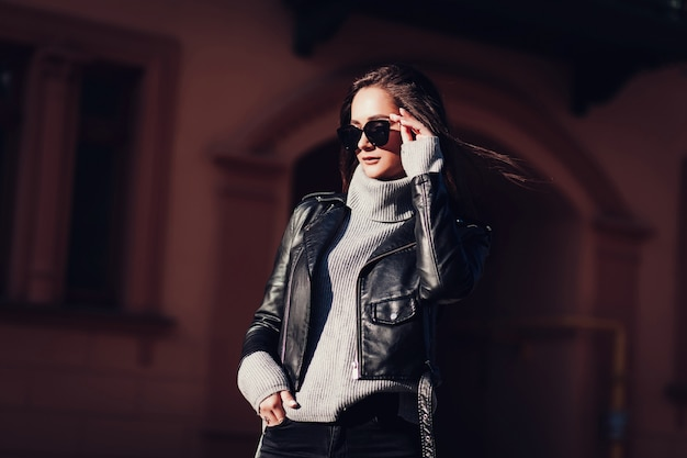 Fashion brunette woman in leather jacket