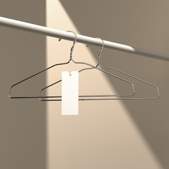 Fashion concept. empty gold hanger with tag. 3d rendering.