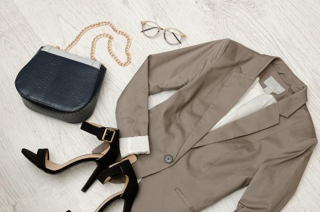 Fashion concept, gray jacket, handbag, sunglasses, shoes and pink tulips,