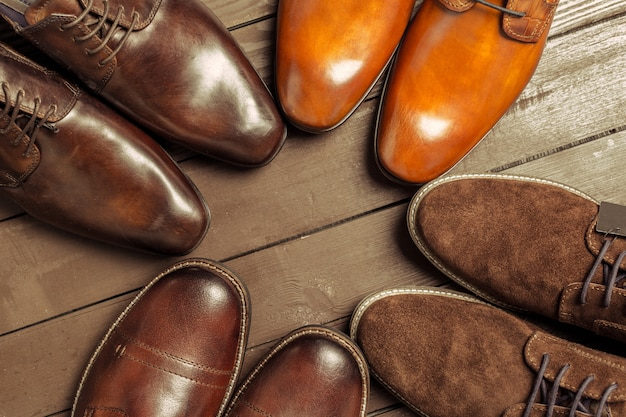 Fashion concept with male shoes on wooden surface
