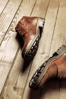 Fashion concept with male shoes on wooden