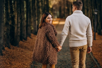 Fashion couple together walking in the park