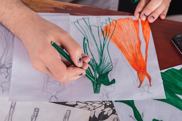 Fashion designer draws a sketch of women's clothing.