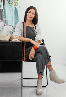 Fashion designer posing on a chair