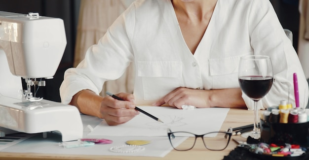 Fashion designer sketching new clothes collection