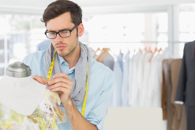 Fashion designer working on floral dress