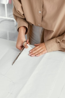Fashion designer working in her workshop alone