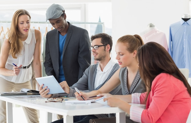 Fashion designers discussing designs