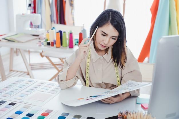 Fashion designers making clothes